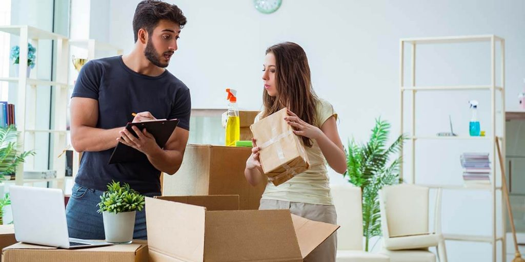 couple making home packing list