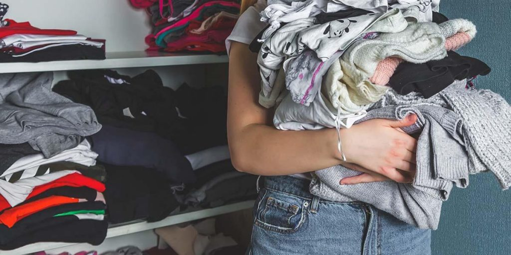 woman packing clothes from wardrobe