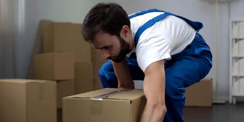 professional packer picking up box
