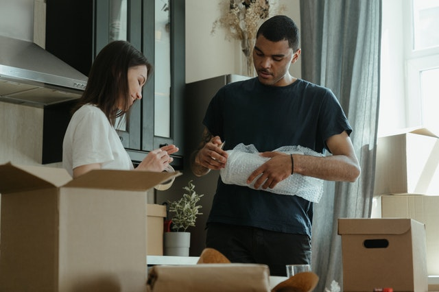 couple preparing their boxes to downsize their home