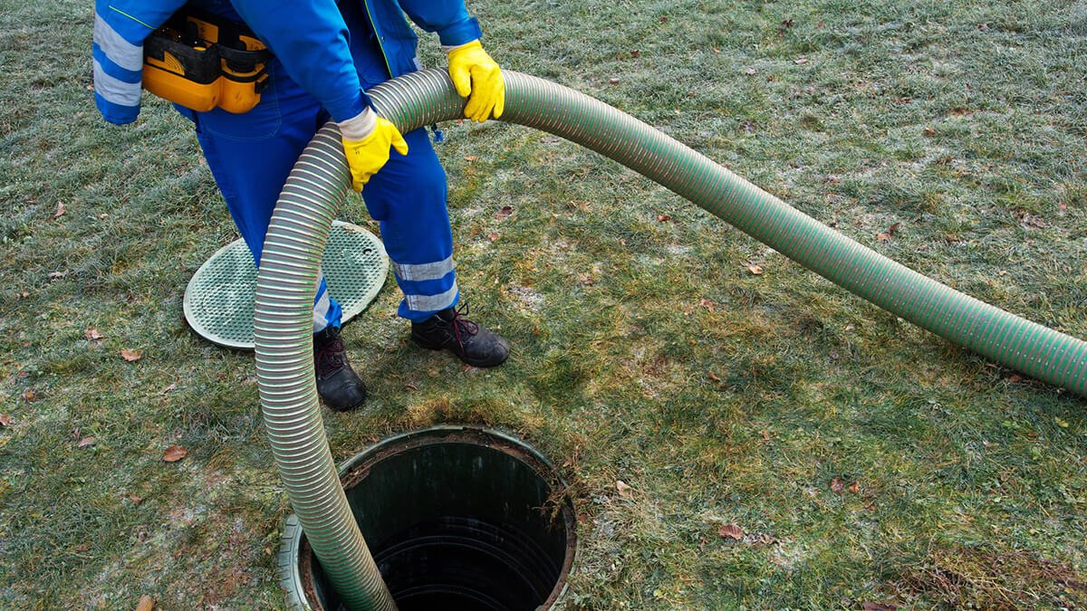 cleaning the septic tank of a rural house for sale