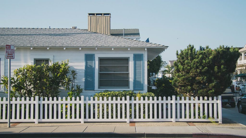house with little white fence